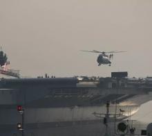 今早国产航母首次起降直升机